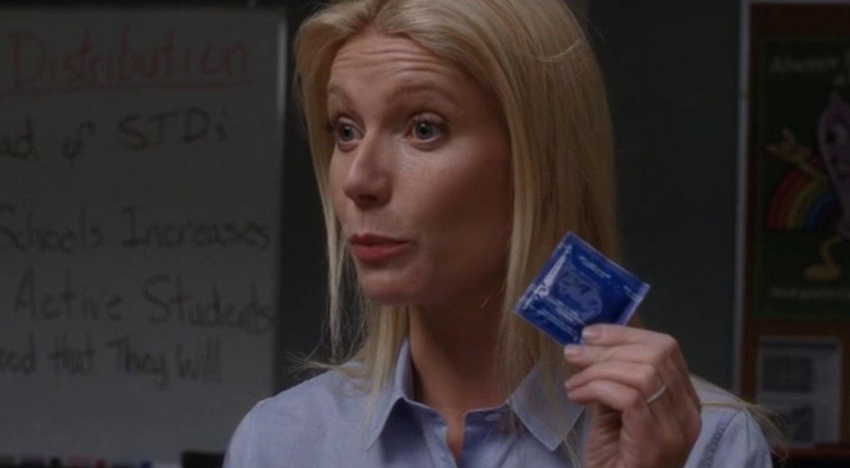 Ms. Holiday holding up a condom for demonstration