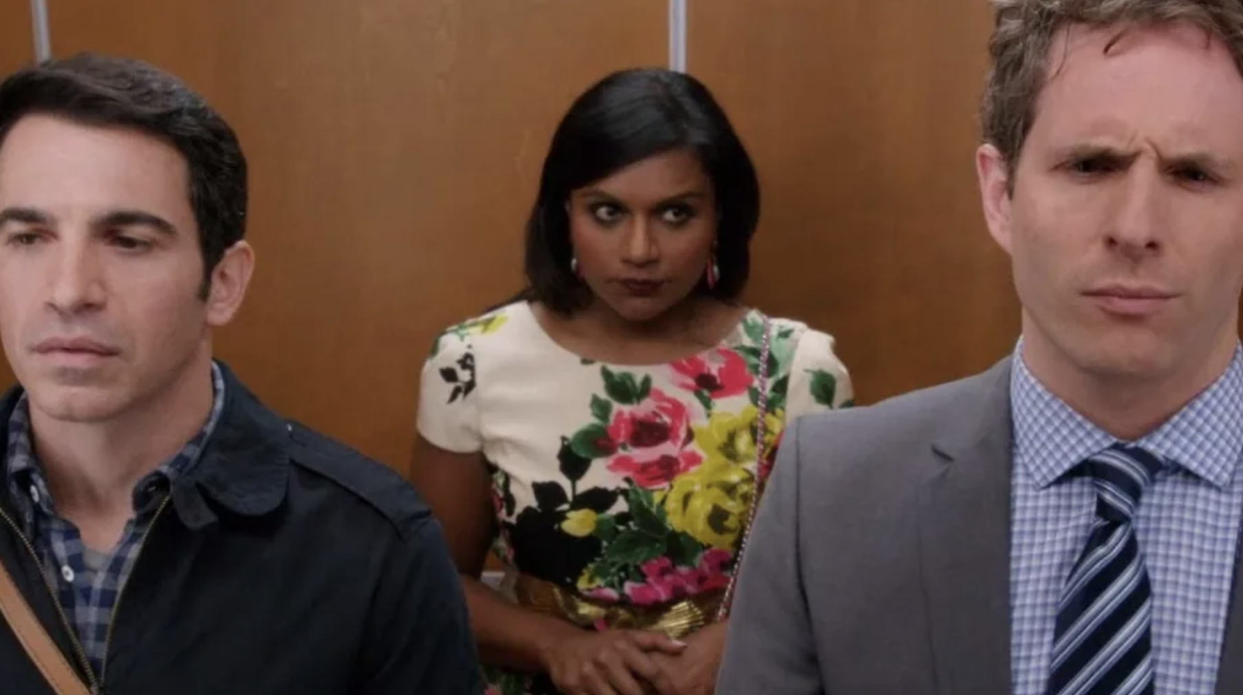Mindy standing in an elevator with Danny and Cliff