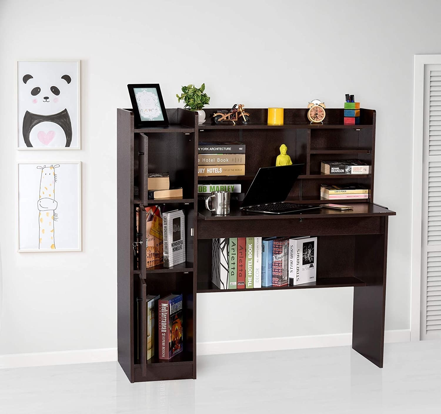 A room with a wooden desk that has multiple storage compartments filled with books and stationery