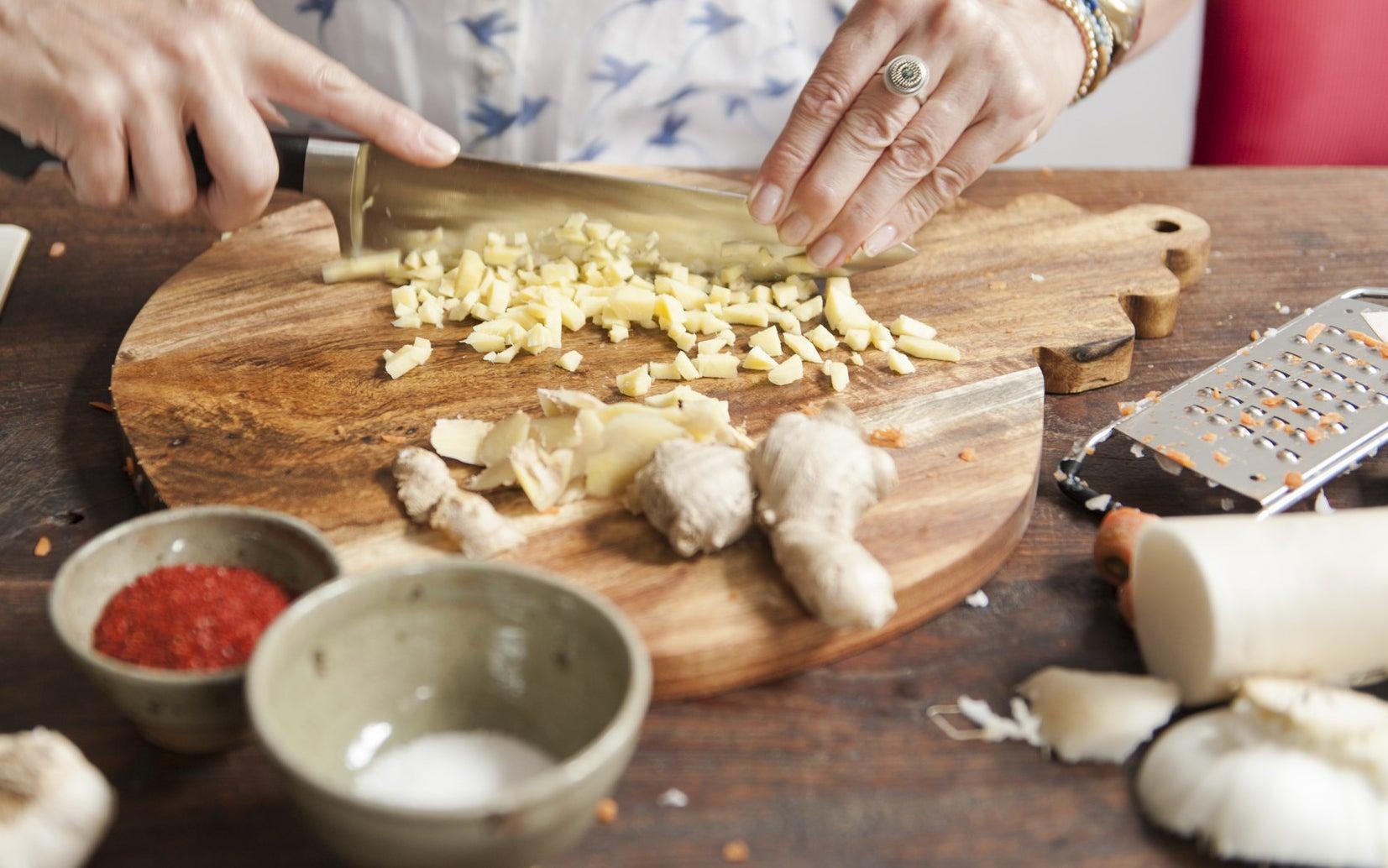 Chopping garlic for an Asian dish.