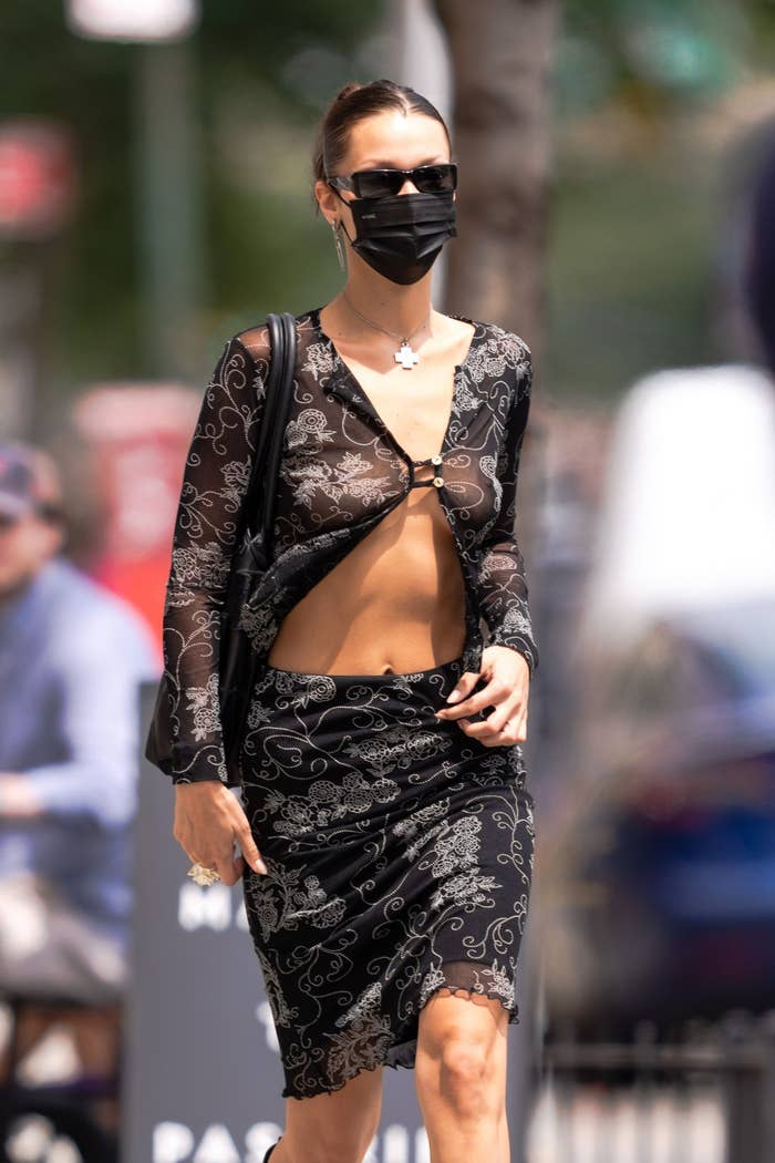 Bella Hadid is pictured wearing a face mask while walking outside in New York City in August 2021