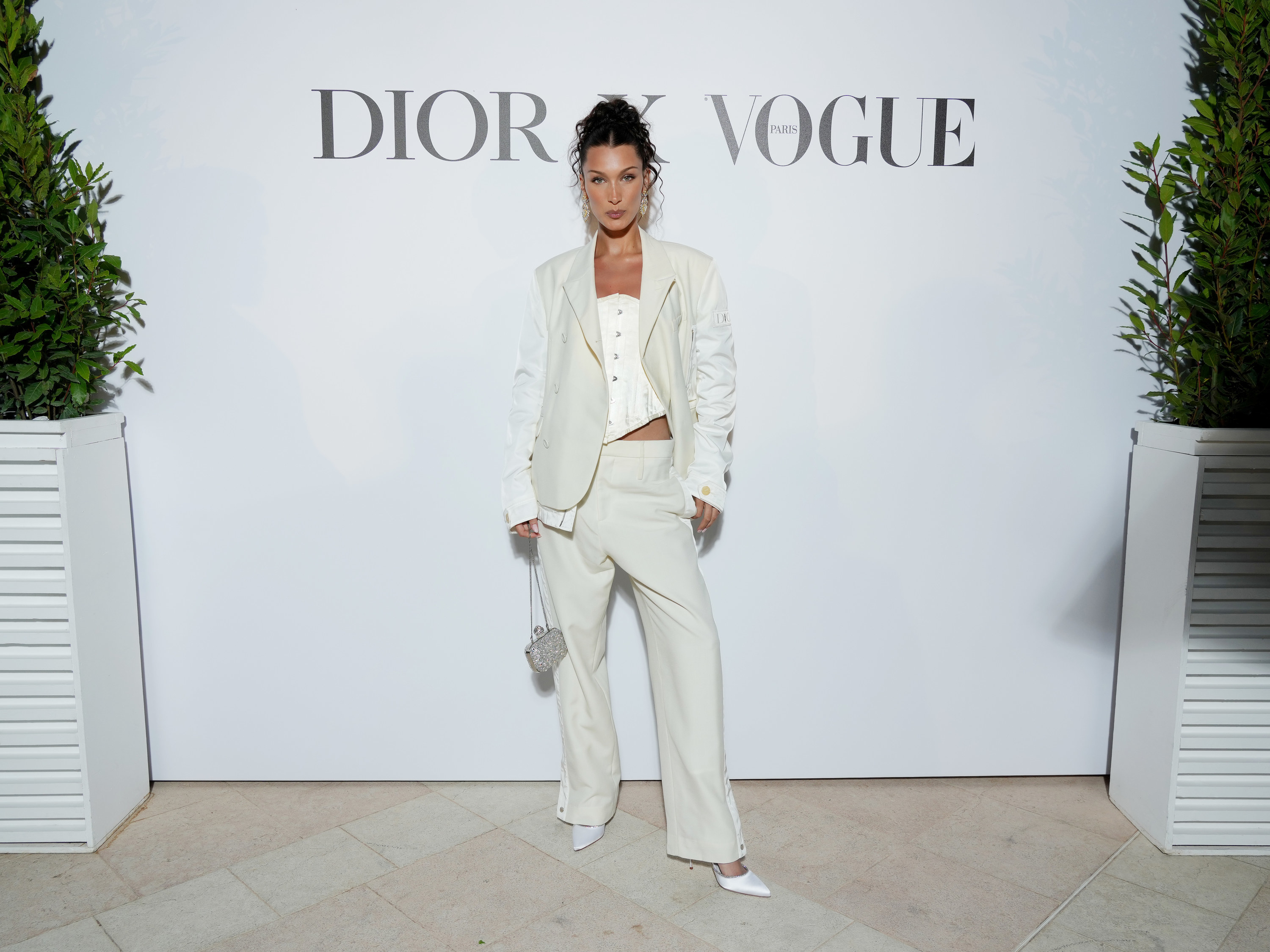 Bella Hadid is pictured wearing a beige suit at the Dior dinner at the Cannes Film Festival in 2021