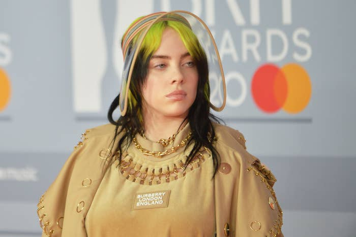 Billie wearing a neutral toned outfit with an oversized visor at the 2020 Brit Awards