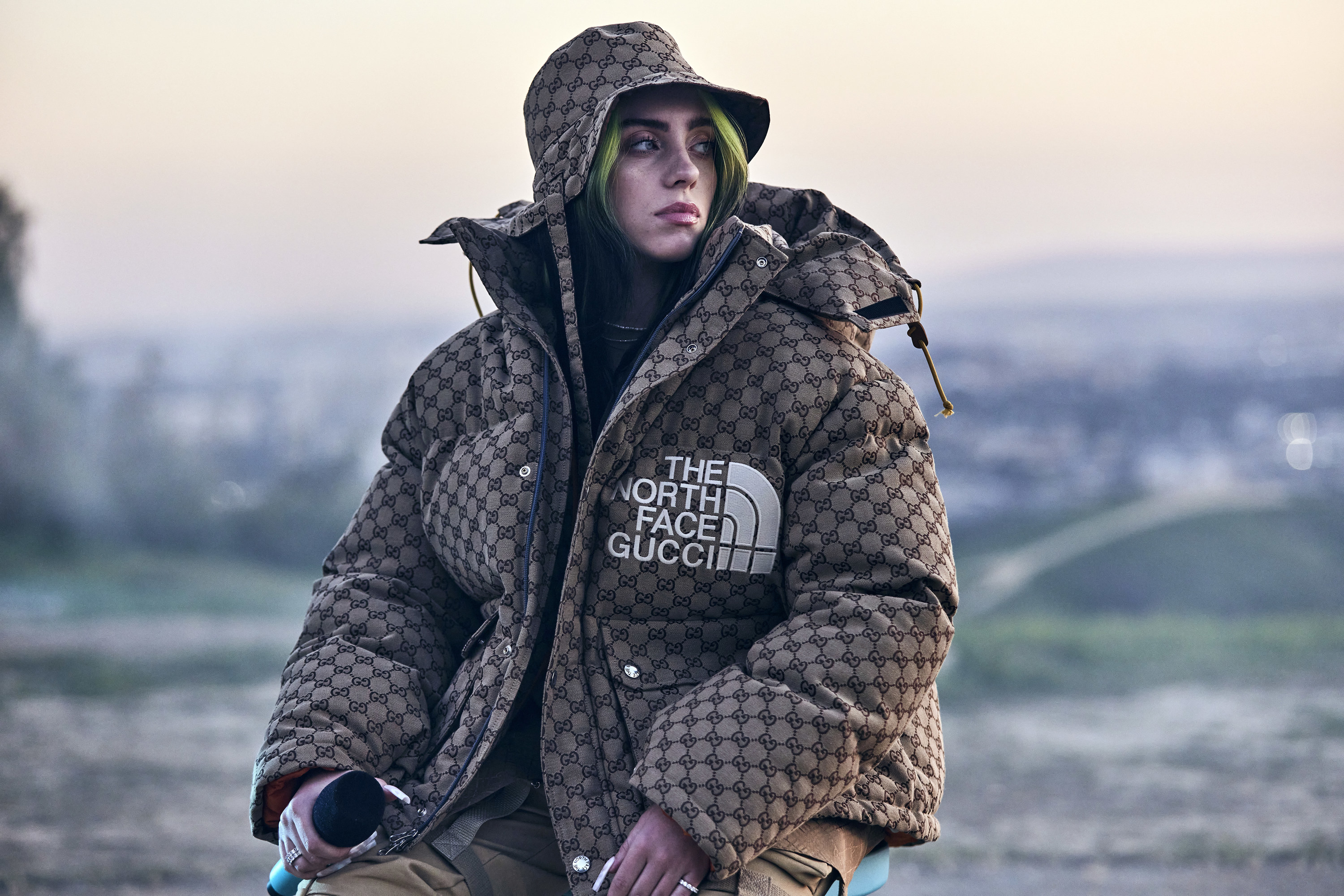Billie wearing a large North Face puffer jacket with matching bucket hat