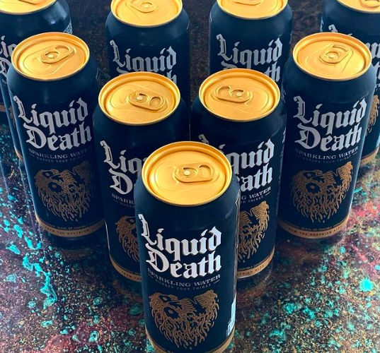 buzzfeed writer's black and gold cans of Liquid Death