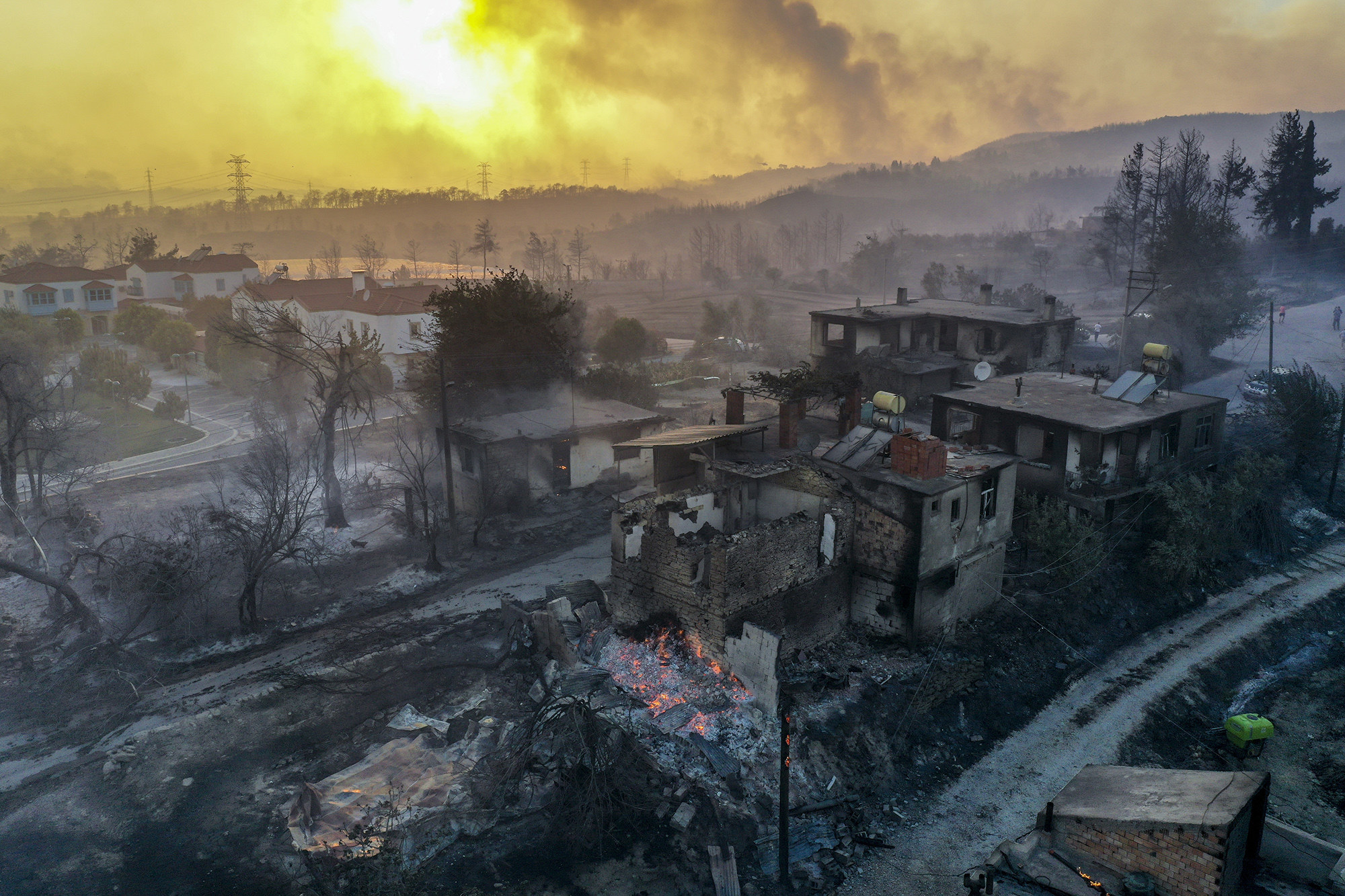 A drone photo shows an aerial view of the aftermath of a fire in Antalya's Manavgat district on July 28