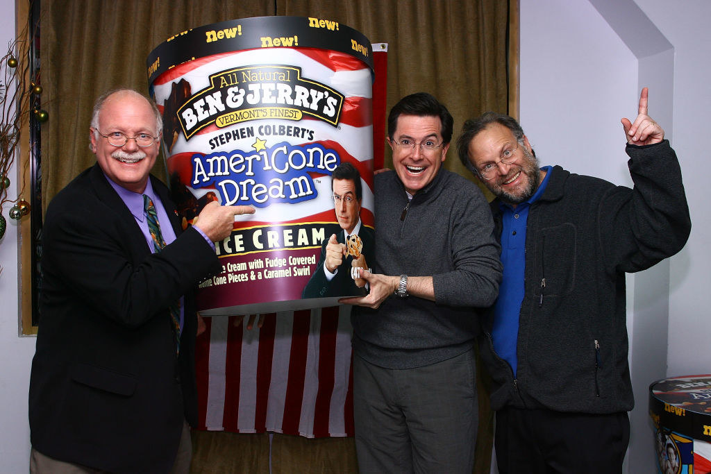 Ben and Jerry pose with Colbert next to a giant fake pint of Americone dream