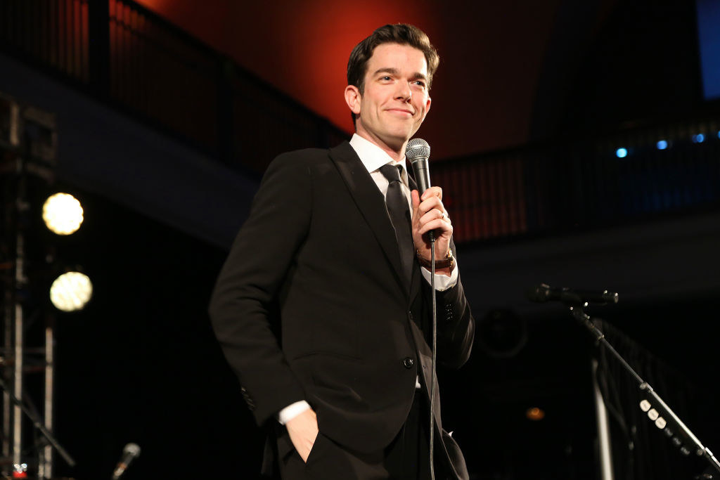 John Mulaney doing stand-up at an event