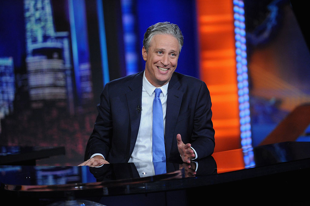 Jon Stewart smiling on set of the Daily Show