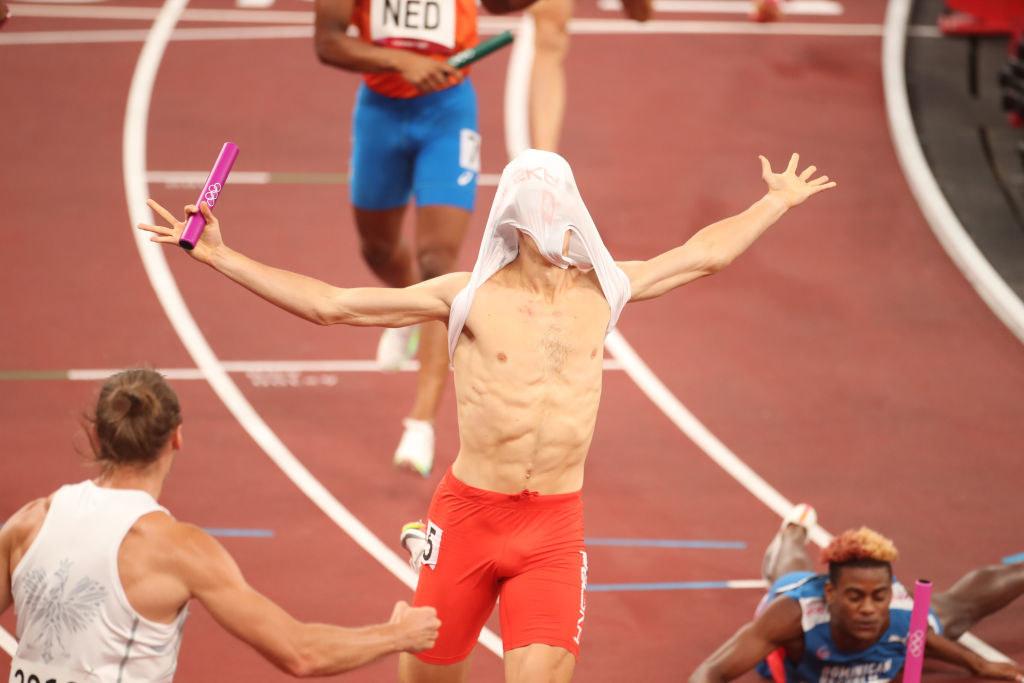 Jakub runs with his shirt over his head