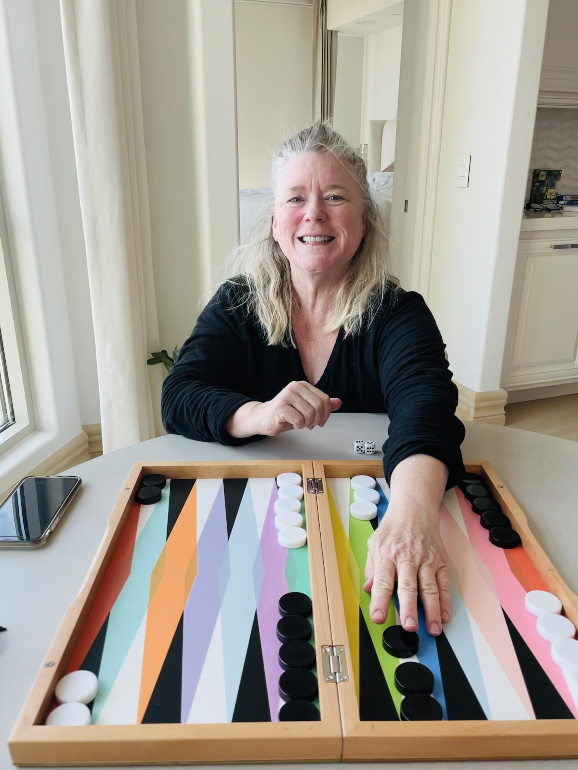 buzzfeeder's mom in front of a colorful, modern backgammon board