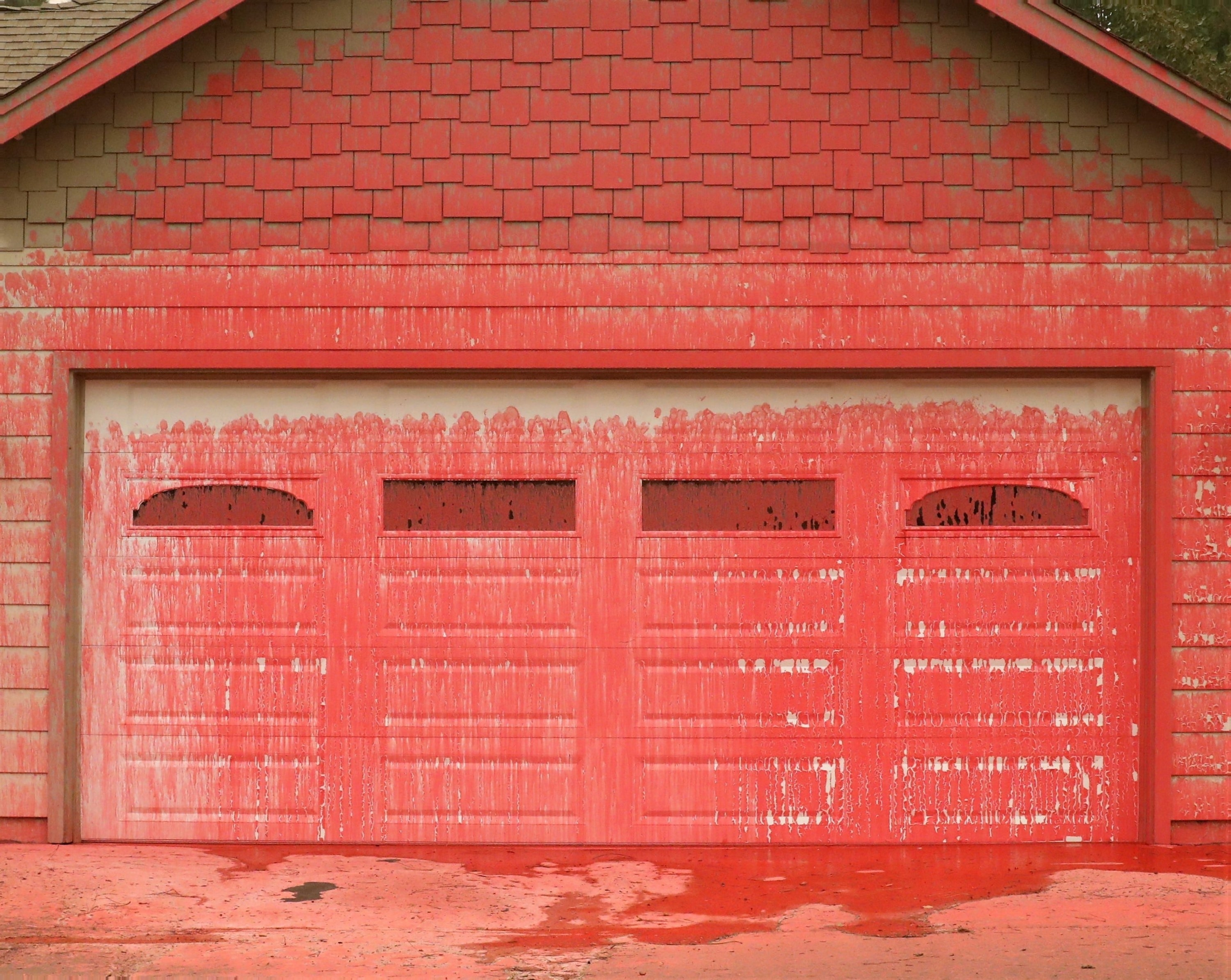 A fire retardant paste covers a garage door and the surrounding walls