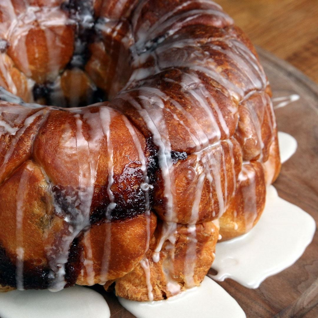 A golden brown Bundt cake with flowing icing