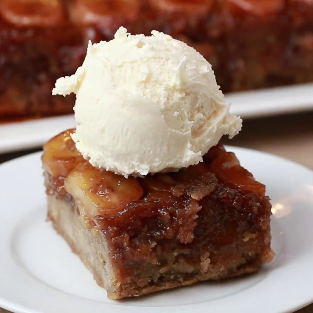 A square section of caramelized banana bread with a single scoop of vanilla ice cream on top