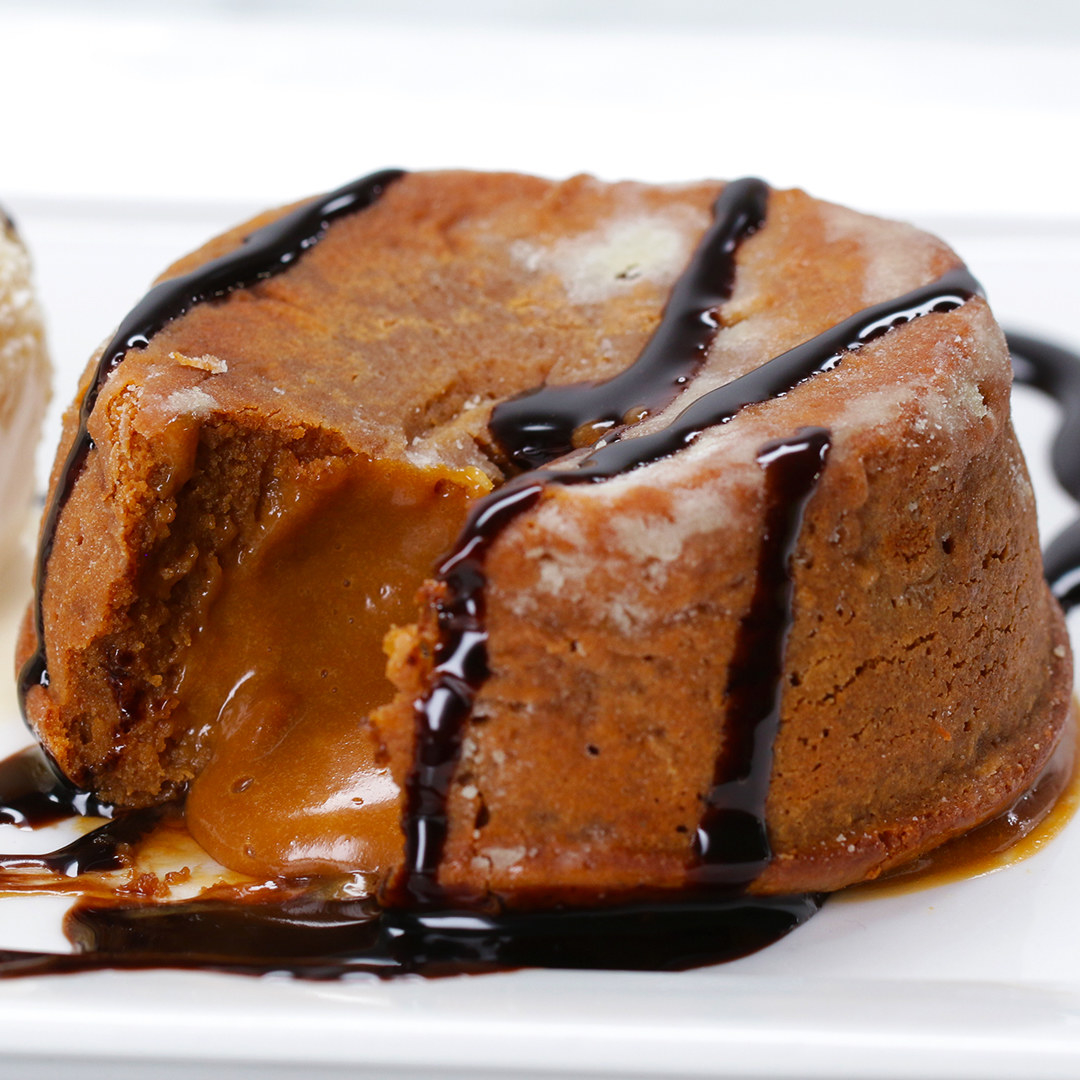 Rich lava cake with oozing caramel at the center and drizzled with chocolate sauce
