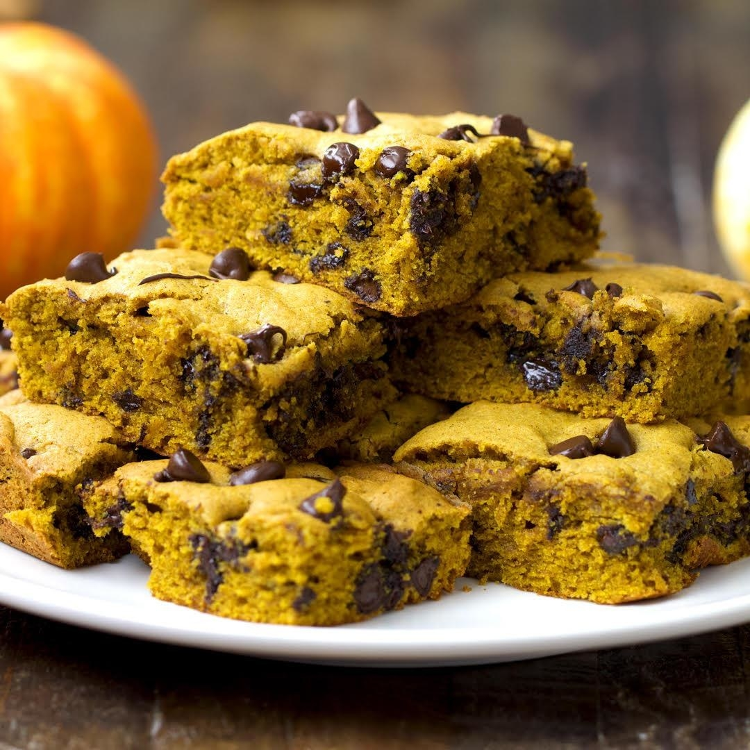 A plate of pumpkin bars sprinkled with chocolate chips