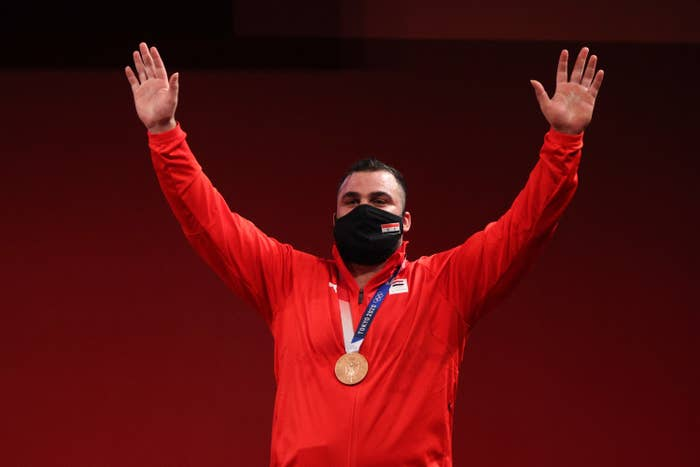 Team Syria's Man Asaad poses with bronze medal