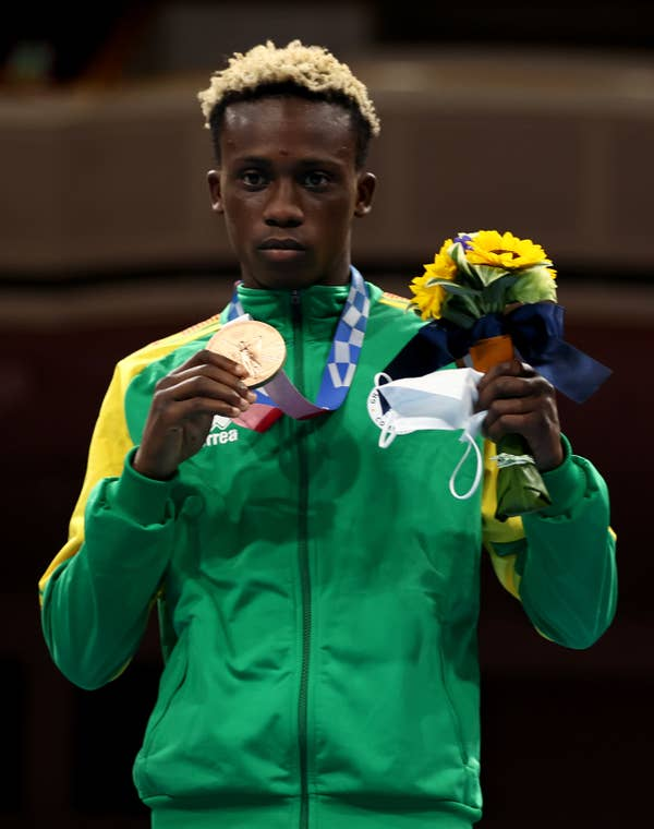 Samuel Takyi poses with bronze medal