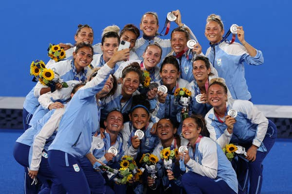 Team Argentina, field hockey, pose with silver medals for a selfie