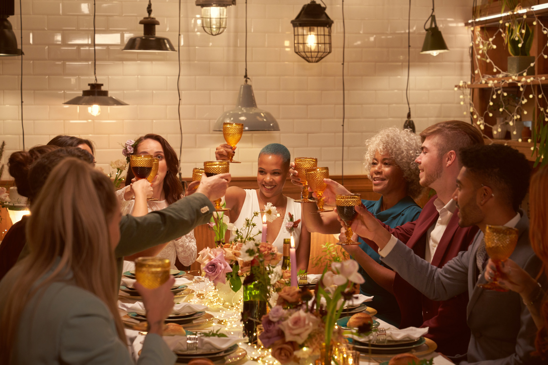 A group of people making a toast at the dinner table