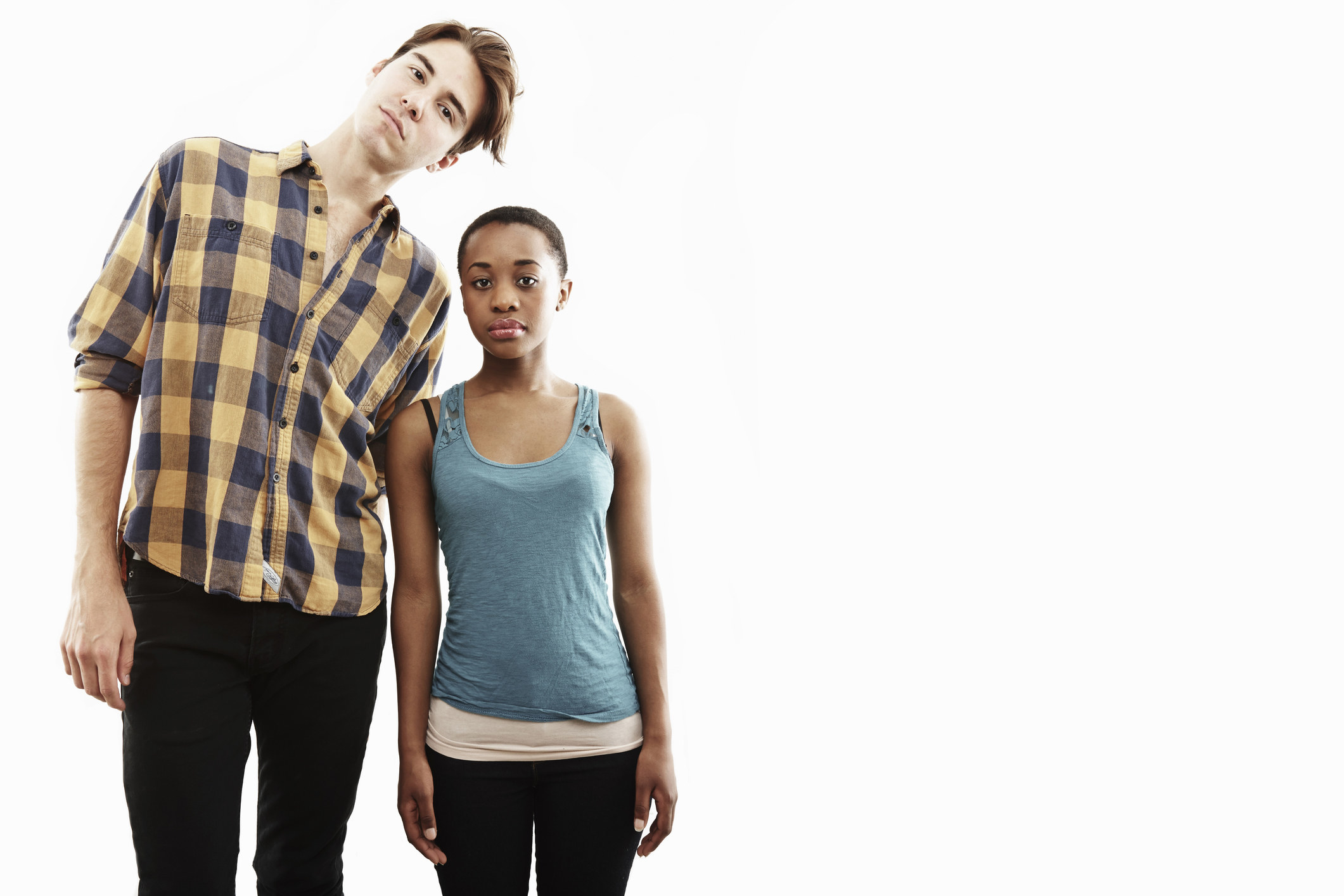 A man very tall man standing next to a much shorter woman