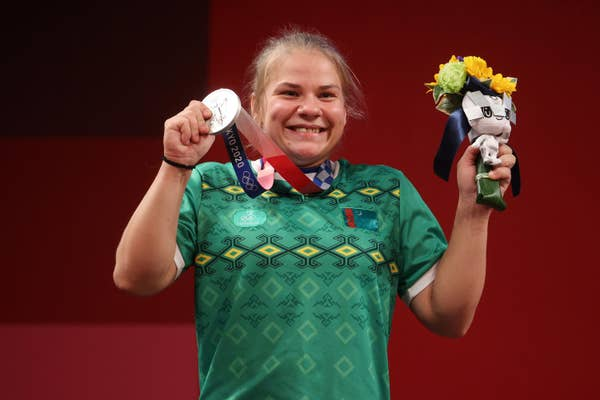 Polina Guryeva of Team Turkmenistan poses with the silver medal
