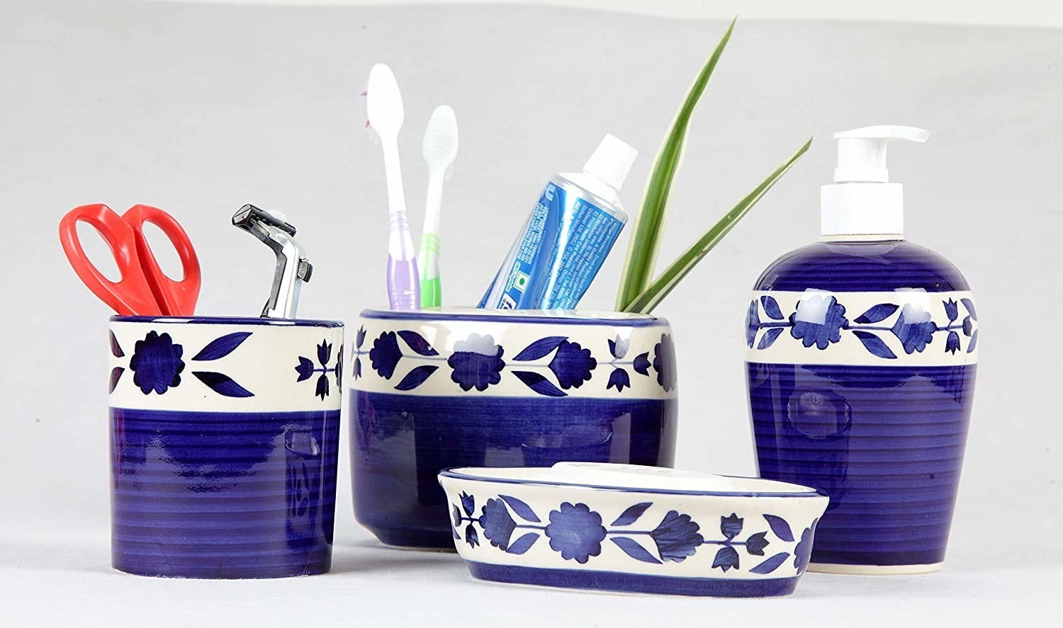 A blue and white floral patterned bathroom accessories set
