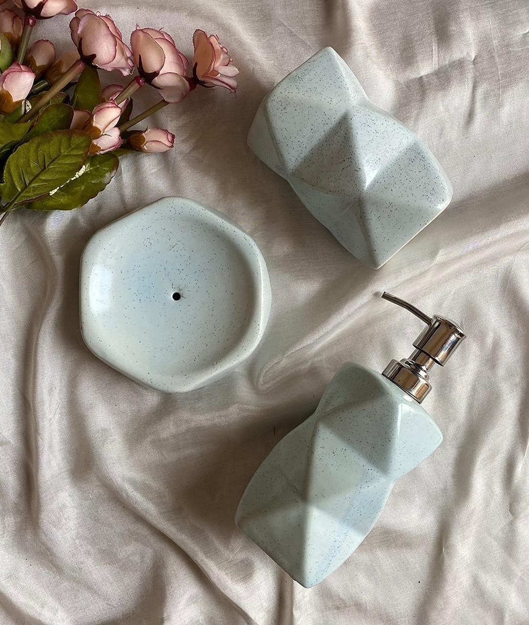 A light blue diamond shaped ceramic soap dispensing set