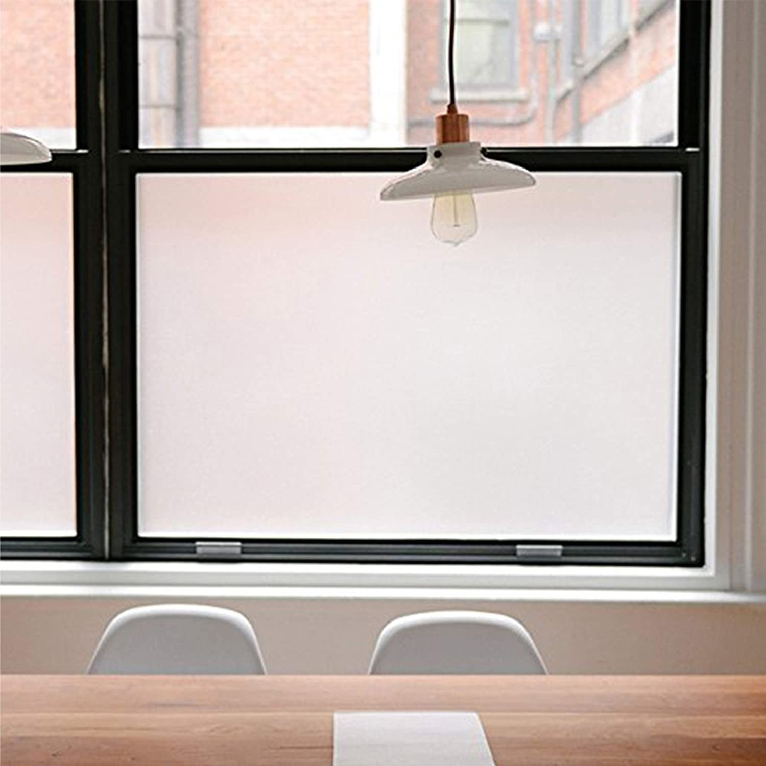 A privacy film on a window in front of chairs