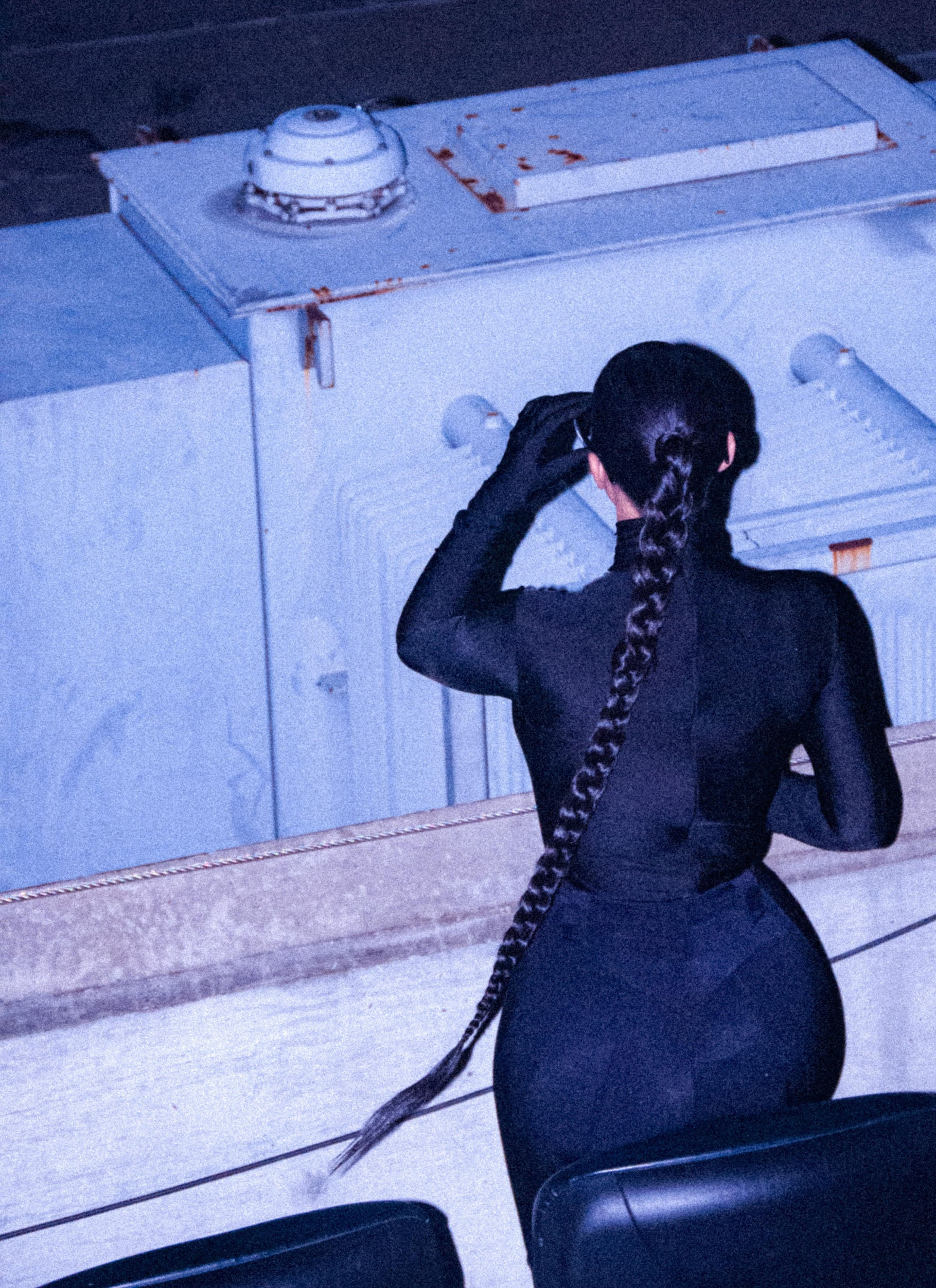 Kim wore a tight, full bodysuit and wore her hair in a long braided ponytail