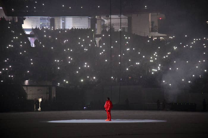 Kanye standing alone in the stadium as his album plays