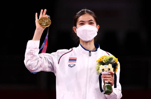 Panipak Wongpattanakit of Team Thailand poses with the gold medal for the Women's Taekwondo