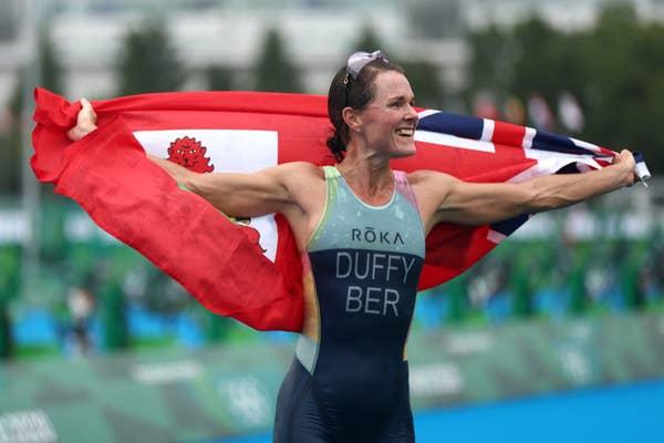 Flora Duffy of Team Bermuda celebrates win draped in Bermuda flag