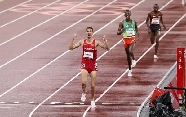 Soufiane El Bakkali of Morocco celebrates on track