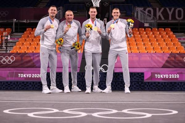 Nauris Miezis, Karlis Lasmanis, Edgars Krumins and Agnis Cavars of Team Latvia pose with their gold medals