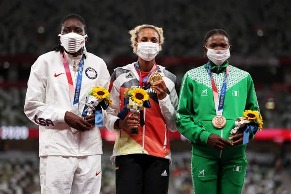 Bronze medalist Ese Brume of Team Nigeria to far right
