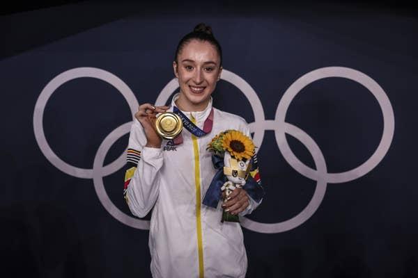 Nina Derwael of Team Belgium poses with the gold medal