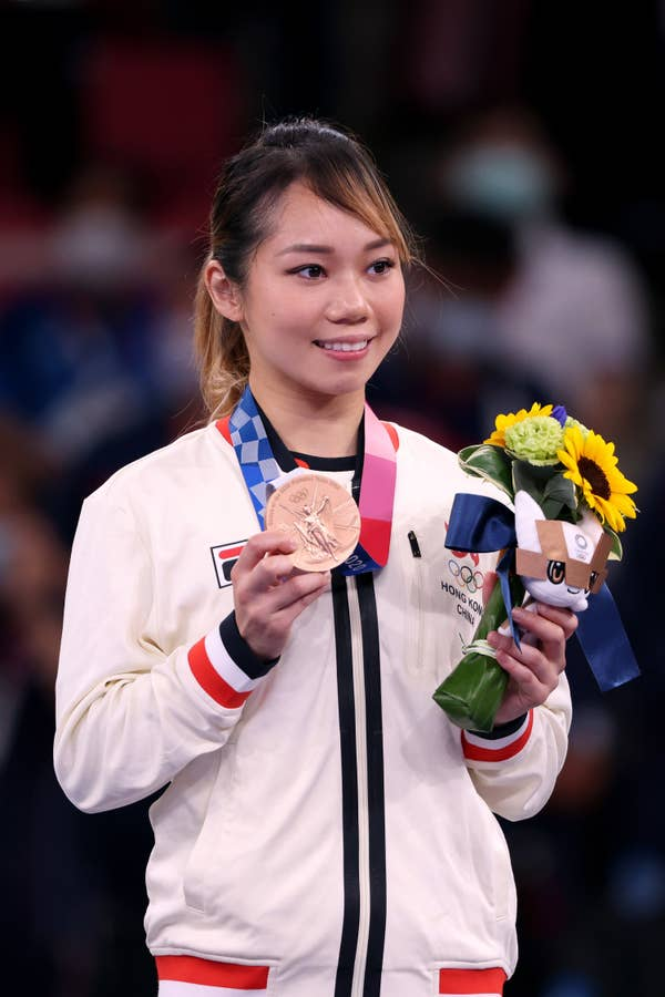 Grace Lau Mo-sheung of Team Hong Kong poses with the bronze medal
