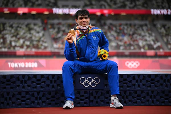 Neeraj Chopra of Team India celebrates on the podium with gold medal