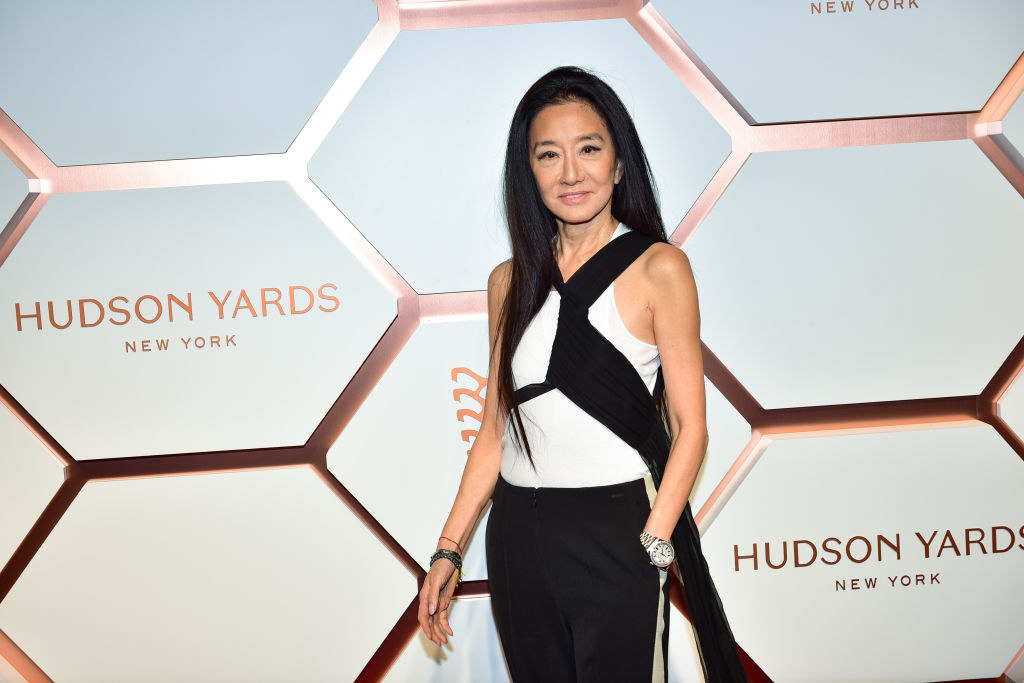 Vera Wang wears a white tee with a wrapped black flowing scarf and black pants to theHudson Yards Grand Opening Party
