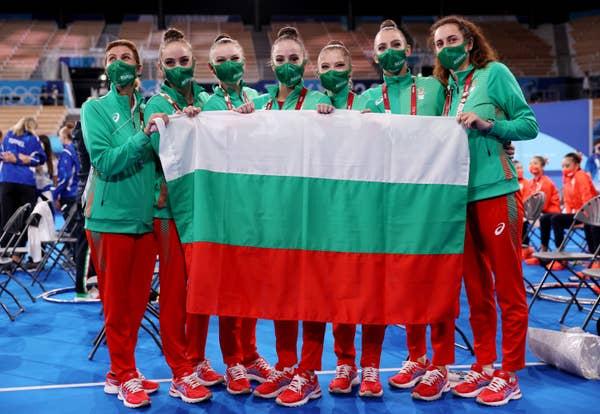 Team Bulgaria (gymnastics) poses with coaches