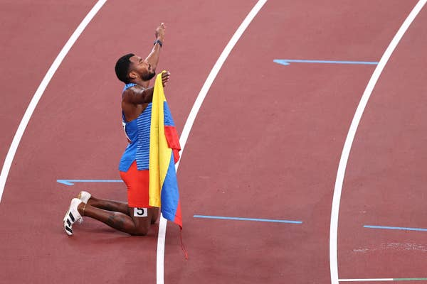 Colombian runner Anthony Jose Zambrano celebrates placing in Men's 400 meter