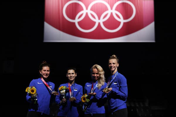 Team Estonia pose with their gold medals