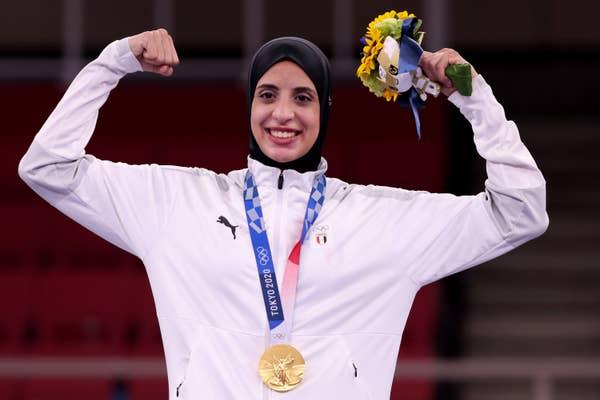 Feryal Abdelaziz of Team Egypt poses with the gold medal