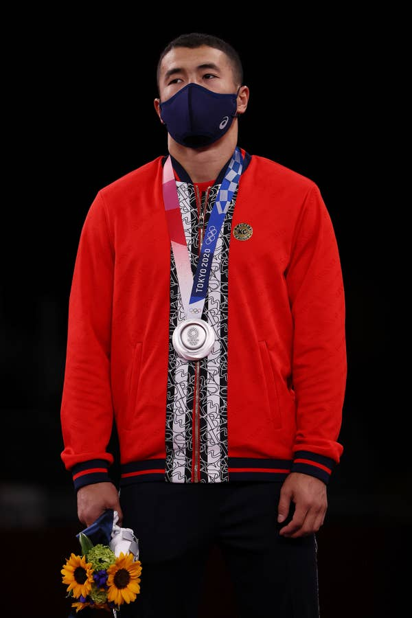 Akzhol Makhmudov of Team Kyrgyzstan poses with the silver medal