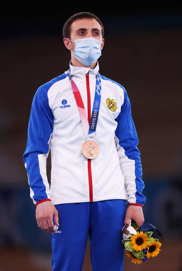 Artur Davtyan of Team Armenia stands with his bronze medal