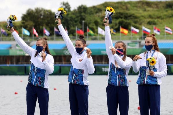 Marharyta Makhneva, Nadzeya Papok, Volha Khudzenka and Maryna Litvinchuk of Team Belarus celebrate silver medals