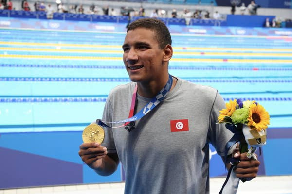 Ahmed Hafnaoui of Tunisia celebrates his gold medal in Men's 400m freestyle