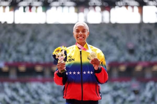 Yulimar Rojas of Team Venezuela poses with gold medal