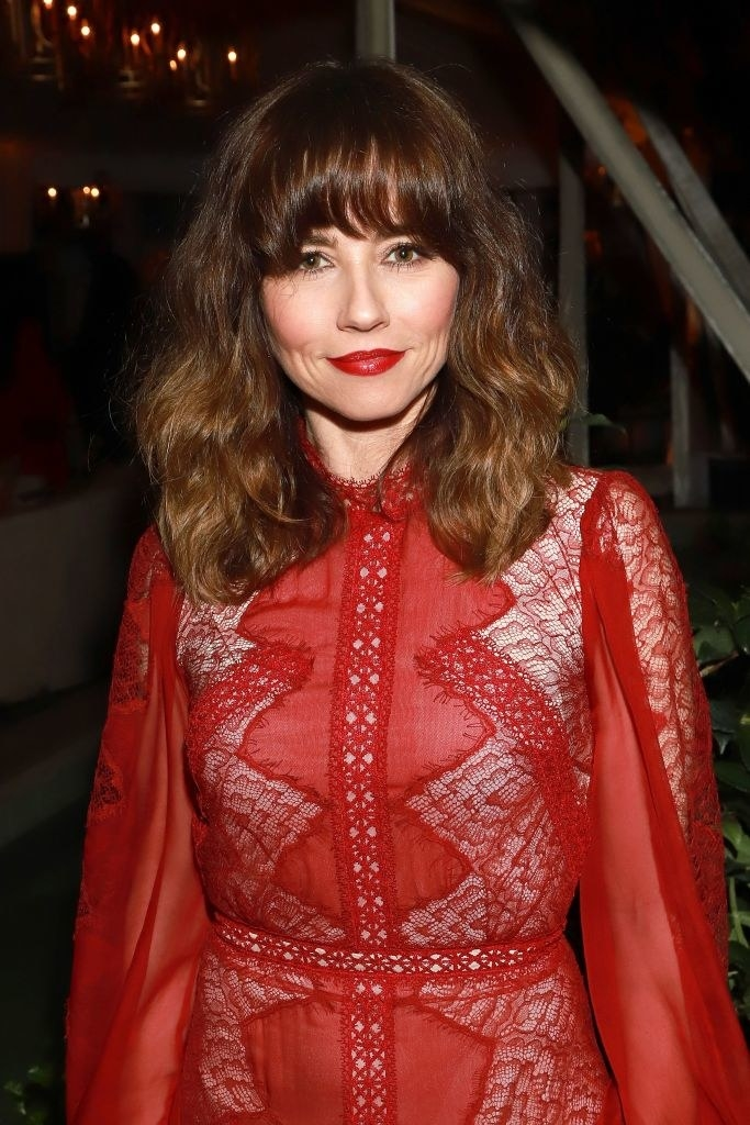 Linda Cardellini in a red lace long-sleeved dress at the2020 Netflix Oscar After Party